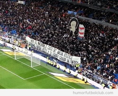 Pancarta de cuarto milenio en el Bernabéu entre el Real Madrid y el Atlético de Madrid