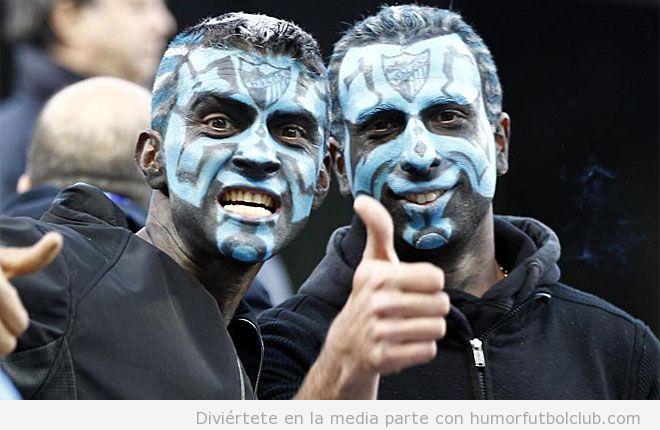 Aficionados en el Málaga vs Borussia Dortmund con cara pintada