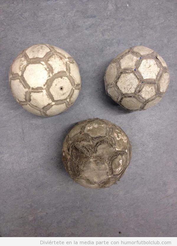 Foto bonita balones de fútbol destrozados que forman corazón